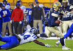 Pittsburgh's Kenny Pickett (8) avoids Duke's Joe Giles-Harris (44) in the fourth quarter of an NCAA college football game, Saturday, Oct. 27, 2018, in Pittsburgh. Pitt won 54-45. (Chaz Palla/Pittsburgh Tribune-Review via AP)
