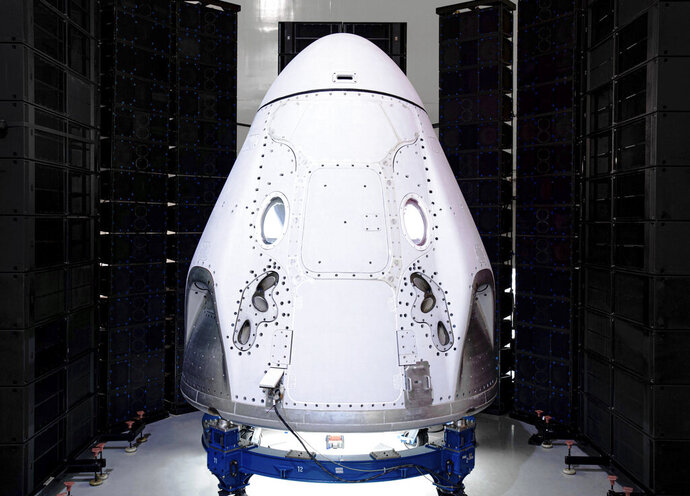 This undated photo made available by SpaceX in February 2020 shows the Crew Dragon spacecraft undergoing acoustic testing in Florida. On Tuesday, Feb. 18, 2020, SpaceX announced it is working with Space Adventures Inc. to take tourists into a high orbit. Ticket prices aren't being divulged but are likely to be in the millions of dollars. (SpaceX via AP)