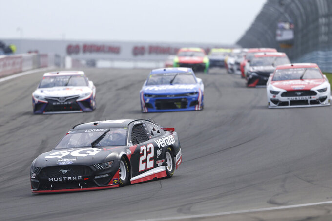 Joey Logano (22) drives through Turn 1 during a NASCAR Cup Series auto race in Watkins Glen, N.Y., on Sunday, Aug. 8, 2021. (AP Photo/Joshua Bessex)