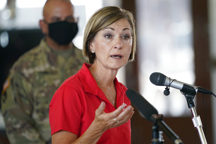 FILE - In this Aug. 14, 2020, file photo, Iowa Gov. Kim Reynolds speaks during a news conference, in Cedar Rapids, Iowa. Reynolds and four top Iowa officials cooperated in making a marketing video for a company that has received no-bid contracts during the state's coronavirus response. The arrangement between the state and Utah-based Domo Inc. has raised allegations of favoritism and improper use of public resources. (AP Photo/Charlie Neibergall, File)