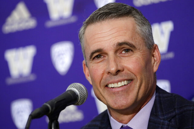 Washington NCAA college football head coach Chris Petersen speaks at a news conference about his decision to resign at the end of the season, Tuesday, Dec. 3, 2019, in Seattle. Petersen unexpectedly resigned on Monday, a shocking announcement with the Huskies coming off a 7-5 regular season and bound for a sixth straight bowl game under his leadership. Petersen will coach Washington in a bowl game, his final game in charge. Defensive coordinator Jimmy Lake is being promoted to head coach. (AP Photo/Elaine Thompson)