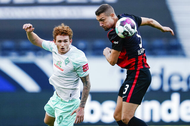 Bremen's Josh Sargent, left, and Frankfurt's Stefan Ilsanker fight for the ball during the German Bundesliga soccer  match between Eintracht Frankfurt and Werder Bremen in Frankfurt, Germany, Saturday, Oct. 31, 2020. (Uwe Anspach//dpa via AP)