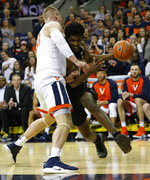 Wake Forest forward Jaylen Hoard, right, tries to get past Virginia center Jack Salt (33) during the first half of an NCAA college basketball game in Charlottesville, Va., Tuesday, Jan. 22, 2019. (AP Photo/Steve Helber)