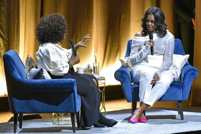 Michelle Obama, right, discusses her new book with Oprah Winfrey during an intimate conversation to promote