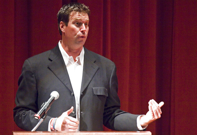 "FILE - In this Oct. 13, 2011, file photo, former Washington State quarterback Ryan Leaf speaks about his first book, ""596 Switch,"" in Pullman, Wash. Leaf has been hired by ESPN to be a college football analyst, another step in the remarkable comeback of the former Washington State star who has battled drug addiction and served time in prison. (Dean Hare/The Moscow-Pullman Daily News via AP, File)"