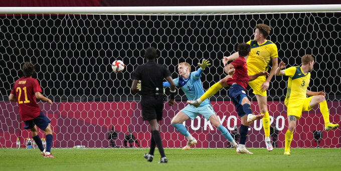Australia's goalkeeper Thomas Glover fails to stop a Spain's first goal by Mikel Oyarzabal during a men's soccer match at the 2020 Summer Olympics, Sunday, July 25, 2021, in Sapporo, Sapporo, Japan. (AP Photo/Silvia Izquierdo)