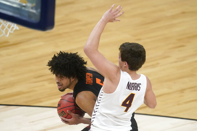 Oregon State guard Ethan Thompson drives to the basket past Loyola Chicago guard Braden Norris (4) during the first half of a Sweet 16 game in the NCAA men's college basketball tournament at Bankers Life Fieldhouse, Saturday, March 27, 2021, in Indianapolis. (AP Photo/Darron Cummings)