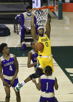 Baylor forward Flo Thamba (0) scores against Alcorn State forward Anthony Fairley (4) and Alcorn State guard Kurk Lee (1) in the first half of an NCAA college basketball game, Wednesday, Dec. 30, 2020, in Waco, Texas. (AP Photo/ Jerry Larson)