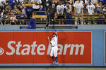 Los Angeles Dodgers center fielder Chris Taylor (3) catches a fly ball hit by San Diego Padres' Manny Machado during the fifth inning of a baseball game Friday, Sept. 10, 2021, in Los Angeles. (AP Photo/Ashley Landis)