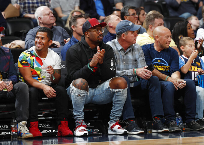 Denver Broncos linebacker Von MIller watches the Denver Nuggets play the Atlanta Hawks duringthe first half of an NBA basketball game Tuesday, Nov. 12, 2019, in Denver. (AP Photo/David Zalubowski)
