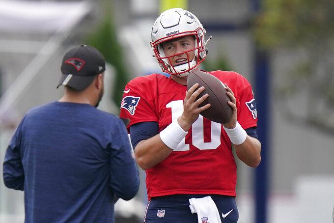 New England Patriots quarterback Mac Jones (10) warms up during NFL football practice, Wednesday, Sept. 15, 2021, in Foxborough, Mass. (AP Photo/Steven Senne)