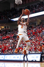 Texas' Matt Coleman III (2) breaks away to lay up the ball during the second half of an NCAA college basketball game against Texas Tech, Saturday, Feb. 29, 2020, in Lubbock, Texas. (AP Photo/Brad Tollefson)