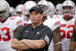 FILE - In this Sept. 28, 2019, file photo, Ohio State head coach Ryan Day waits with his players before taking the field for an NCAA college football game against Nebraska, in Lincoln, Neb. A year ago, Day was a relatively unknown Ohio State assistant. This December he's reigning Big Ten coach of the year and is eyeing a national title after leading the Buckeyes to a 13-0 record as the successor to the retiring Urban Meyer. (AP Photo/Nati Harnik, File)