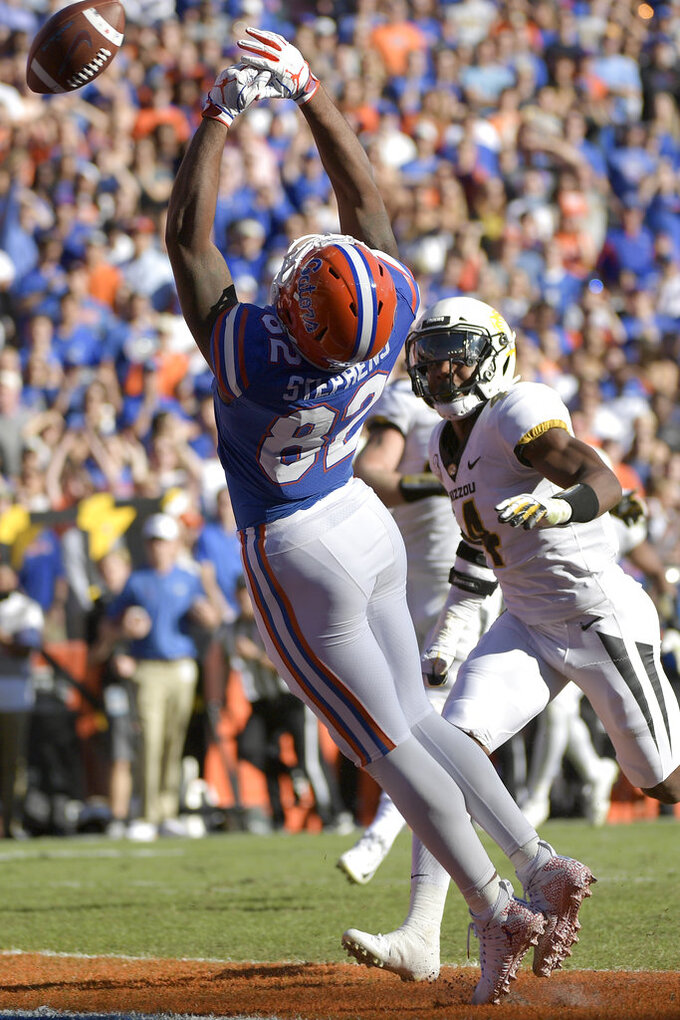 Florida tight end Moral Stephens (82) misses a pass in the end zone in front of Missouri linebacker Brandon Lee (4) during the first half of an NCAA college football game Saturday, Nov. 3, 2018, in Gainesville, Fla. (AP Photo/Phelan M. Ebenhack)