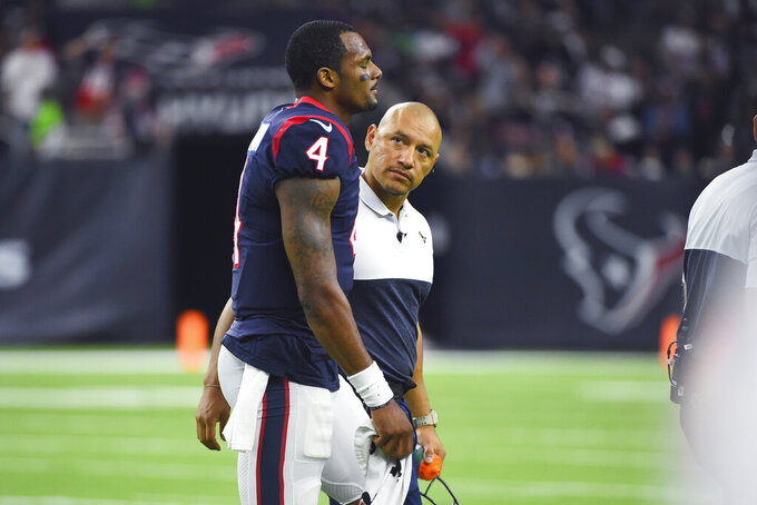 Houston Texans quarterback Deshaun Watson (4) is helped off of the field after he was injured during the second half of an NFL football game against the Oakland Raiders Sunday, Oct. 27, 2019, in Houston. (AP Photo/Eric Christian Smith)