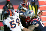 New England Patriots quarterback Cam Newton, rear, fumbles in the second half of an NFL football game against the Denver Broncos, Sunday, Oct. 18, 2020, in Foxborough, Mass. (AP Photo/Steven Senne)