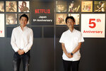 """In this photo released by Netflix, Kaata Sakamoto, left, director of its content acquisition, and filmmaker Shinsuke Sato attend a livestream held from the Netflix Tokyo office on Sept. 7, 2020. After five years in Japan, Netflix now has 5 million households that have signed with the video-streaming service. The coronavirus pandemic, which has people staying home, has helped. But that number is still a fraction of Netflix's 193 million global paid members, and just 10% of Japan, where old-fashioned TV remains popular. Sato directs a live-action adaptation of cult manga, """"Alice in Borderland"""" for Netflix. (Netflix via AP)"""