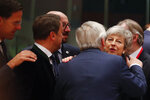 British Prime Minister Theresa May, right, speaks with European Commission President Jean-Claude Juncker, center, during a round table meeting at an EU summit in Brussels, Thursday, March 21, 2019. British Prime Minister Theresa May is trying to persuade European Union leaders to delay Brexit by up to three months, just eight days before Britain is scheduled to leave the bloc. (AP Photo/Frank Augstein)