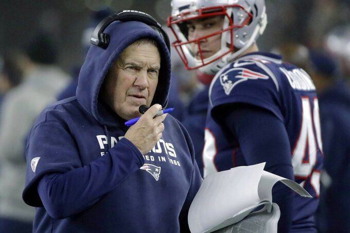 FILE - In this Jan. 4, 2020, file photo, New England Patriots coach Bill Belichick works along the sideline in the first half of the team's NFL wild-card playoff football game against the Tennessee Titans in Foxborough, Mass. This could be the year Buffalo, Miami or the New York Jets end New England's reign at the top of the division after winning 17 titles in 19 years with Tom Brady as quarterback. But Bill Belichick is still running things for the Patriots. That has all of their AFC East rivals still wary and not quite ready to say the division is up for grabs. (AP Photo/Elise Amendola, FIle)