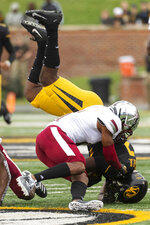 Missouri tight end Daniel Parker Jr., bottom, is flipped as he is tackled by Troy cornerback Dell Pettus, top, during the second quarter of an NCAA college football game Saturday, Oct. 5, 2019, in Columbia, Mo. (AP Photo/L.G. Patterson)