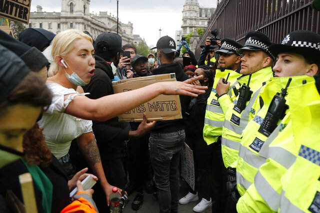 A protester yells at police during the Black Lives Matter protest rally in London, Sunday, June 7, 2020, in response to the recent killing of George Floyd by police officers in Minneapolis, USA, that has led to protests in many countries and across the US. (AP Photo/Frank Augstein)