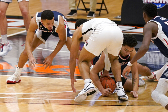 Pacific guard Pierre Crockrell II, center, vies for the ball with Gonzaga's Jalen Suggs, left, and Anton Watson, right, during the first half of an NCAA college basketball game in Stockton, Calif., Thursday, Feb. 4, 2021. (AP Photo/Rich Pedroncelli)