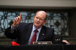 Sen. Chris Coons, D-Del., speaks during a Senate Judiciary Committee business meeting to consider authorization for subpoenas relating to the Crossfire Hurricane investigation, and other matters on Capitol Hill in Washington, Thursday, June 11, 2020. (AP Photo/Carolyn Kaster, Pool)