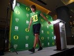 Oregon senior quarterback Justin Herbert leaves the stage after taking questions during the NCAA college football team's media day Friday, Aug. 2, 2019, in Eugene, Ore. (Andy Nelson/The Register-Guard via AP)