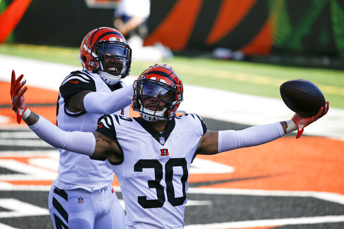 Cincinnati Bengals' Jessie Bates (30) celebrates an interception with LeShaun Sims (38) during the first half of an NFL football game against the Tennessee Titans, Sunday, Nov. 1, 2020, in Cincinnati. (AP Photo/Gary Landers)