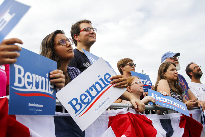 Supporters look up at Bernie Sanders during a rally at Reaves Park in Norman, Okla., Sunday, Sept. 22, 2019. (Paxson Haws/The Oklahoman via AP)