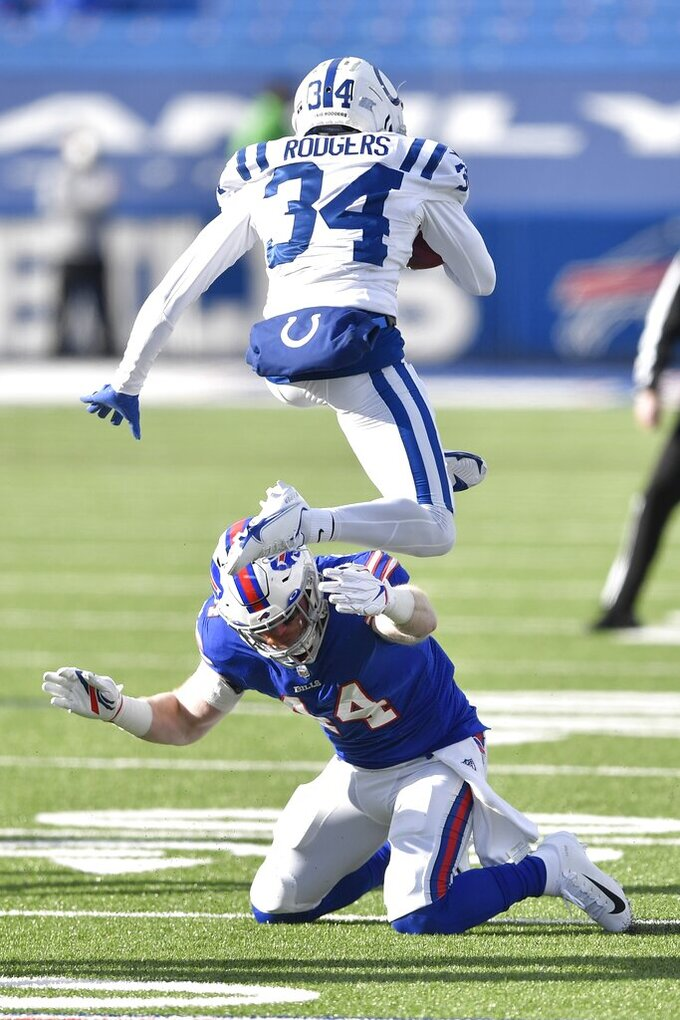 Indianapolis Colts' Isaiah Rodgers (34) leaps over Buffalo Bills' Tyler Matakevich (44) while while returning a kickoff during the first half of an NFL wild-card playoff football game Saturday, Jan. 9, 2021, in Orchard Park, N.Y. (AP Photo/Adrian Kraus)