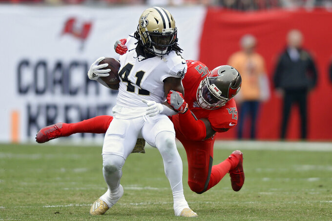 New Orleans Saints running back Alvin Kamara (41) gets stopped by Tampa Bay Buccaneers linebacker Devin White (45) after a run during the first half of an NFL football game Sunday, Nov. 17, 2019, in Tampa, Fla. (AP Photo/Jason Behnken)