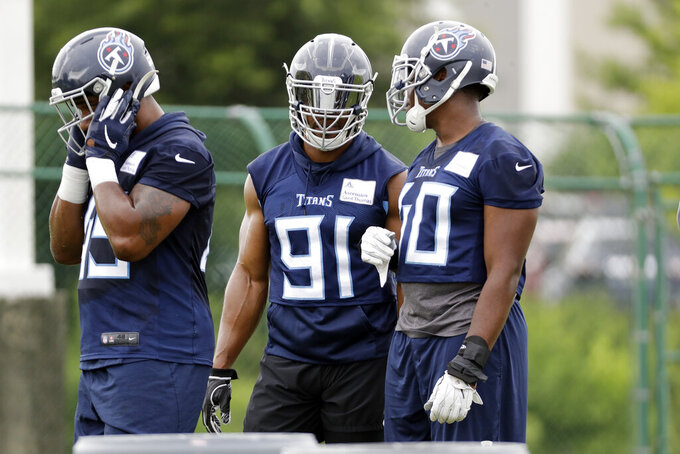 Tennessee Titans outside linebacker Cameron Wake (91) waits to run a drill during an organized team activity at the Titans' NFL football training facility Tuesday, June 4, 2019, in Nashville, Tenn. Fans have been wanting to know how Tennessee will get more sacks after the retirement of Brian Orakpo and the free agent signing of 37-year-old Cameron Wake. (AP Photo/Mark Humphrey)