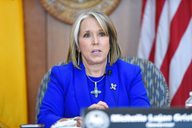 New Mexico Gov. Michelle Lujan Grisham speaks about the uptick in confirmed COVID-19 cases in the state and her decision to hold off on opening more of the economy during a news conference at the state Capitol on Thursday, June 25, 2020. (Eddie Moore/Albuquerque Journal via AP)