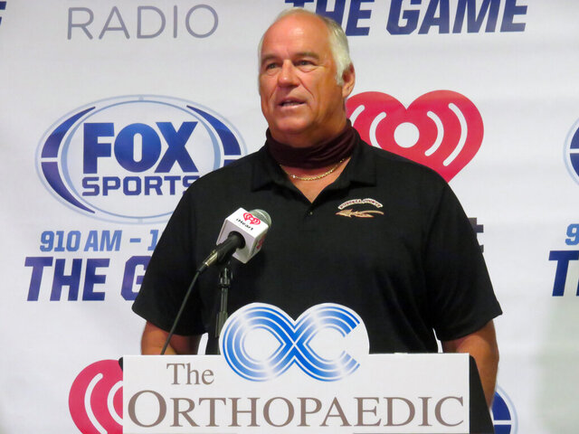 Russell County head football coach Mark Rose speaks during High School Football Media Days in Opelika, Ala., on July 22, 2020.  Football is Mark Rose's life. He was an undersized lineman on Auburn's SEC championship teams of the late 1980s under Pat Dye. He's been a high school coach for three decades. But there was no way Rose was sending his players onto the field in the middle of a pandemic.(Jordan D. Hill/Opelika-Auburn News via AP)