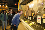 Caleb Followill, right, looks at a Beatles display at the Rock and Roll Hall of Fame Thursday, April 29, 2021, in Cleveland. Rockers Kings of Leon toured a new digital exhibit at the Rock and Roll Hall of Fame for the NFT (cryptocurrency) launching before the rock band plays at the NFL draft, Thursday, April 29, 2021, in Cleveland. (AP Photo/Tony Dejak)
