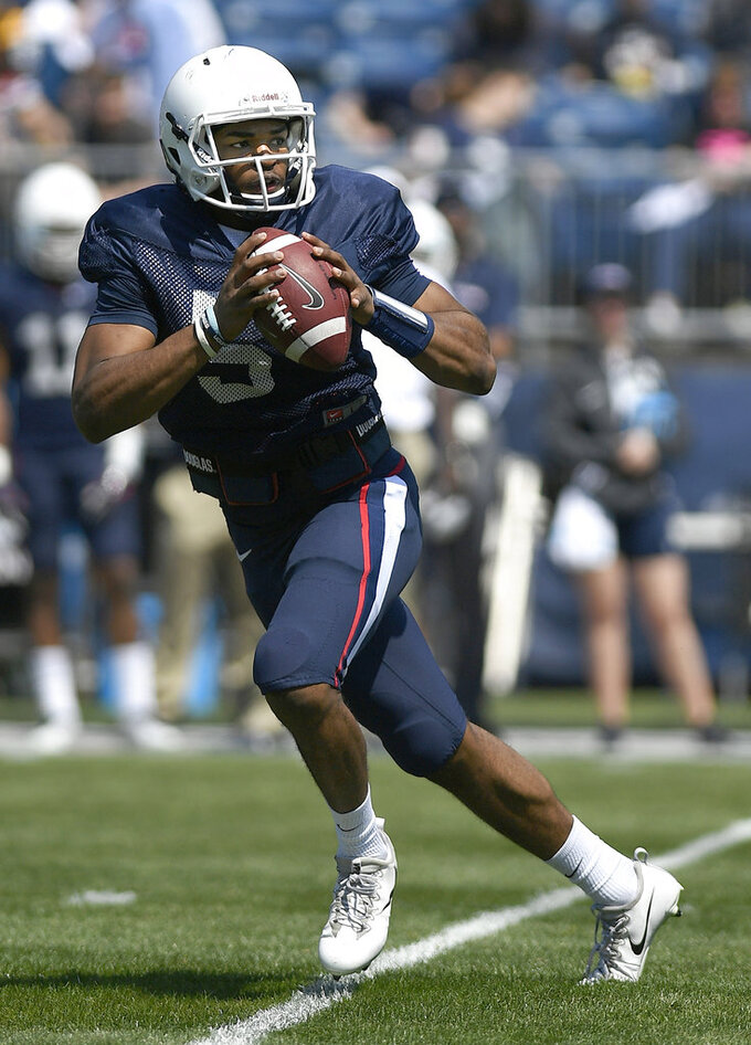 FILE - In this April 14, 2018, file photo, quarterback David Pindell looks to pass during Connecticut's annual spring NCAA college football game in East Hartford, Conn. UConn will host Central Florida to open the regular season on Thursday night, Aug. 30. (AP Photo/Jessica Hill, File)