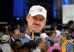 A Pittsburgh Steelers fan holds a cutout of former coach Bill Cowher during the 2020 Centennial Pro Football Hall of Fame Class induction Saturday, Aug 7, 2021, in Canton, Ohio. (Matt Freed/Pittsburgh Post-Gazette via AP)