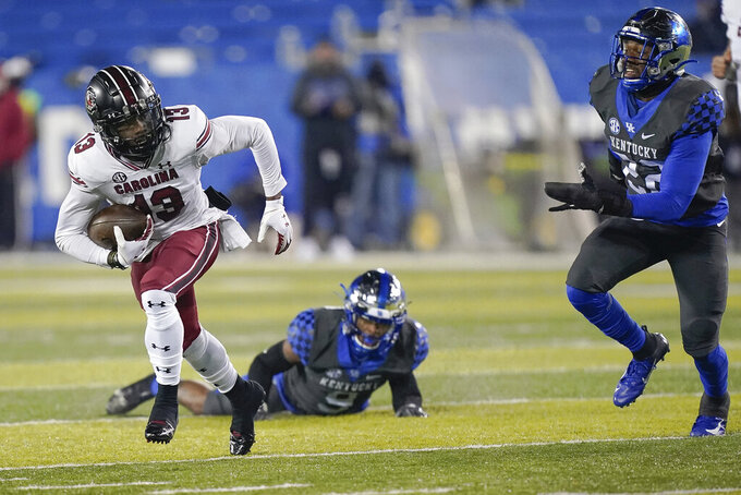 South Carolina wide receiver Shi Smith (13) runs with the ball during the second half of an NCAA college football game against Kentucky, Saturday, Dec. 5, 2020, in Lexington, Ky. (AP Photo/Bryan Woolston)