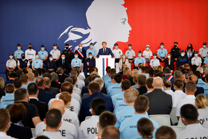 French President Emmanuel Macron speaks during his visit at the police academy of Roubaix, northern France, Tuesday, Sept. 14, 2021. (Ludovic Marin, Pool via AP)