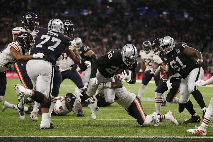 Oakland Raiders running back Josh Jacobs (28) breaks a tackle and goes in for a touchdown during the first half of an NFL football game against the Chicago Bears at Tottenham Hotspur Stadium, Sunday, Oct. 6, 2019, in London. (AP Photo/Tim Ireland)