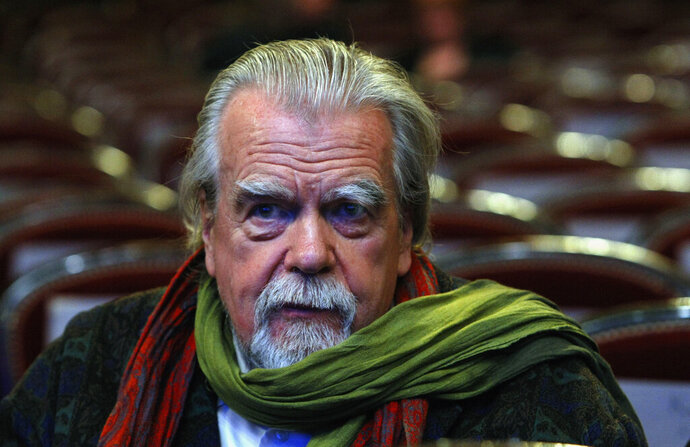FILE - In this Feb.25, 2011 file photo , French actor Michael Lonsdale, awarded for the Supporting Actor, attends prior to the annual Cesar 36th Awards ceremony, in Paris. Michael Lonsdale, a French-British actor and giant of the silver screen and theatre in France, died on Monday, his agent said. From his role as villain in the 1979 James Bond film