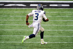 Seattle Seahawks quarterback Russell Wilson (3) runs in the open field against the Atlanta Falcons during the second half of an NFL football game, Sunday, Sept. 13, 2020, in Atlanta. (AP Photo/Brynn Anderson)