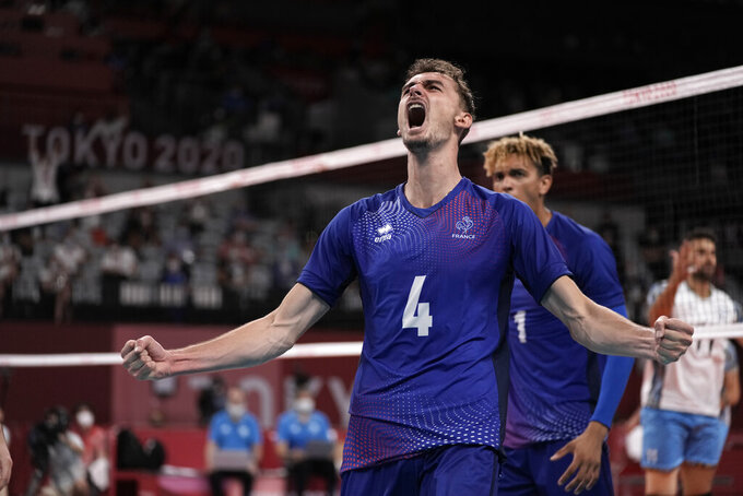 France's Jean Patry celebrates a point during a men's volleyball semifinal match against Argentina, at the 2020 Summer Olympics, Thursday, Aug. 5, 2021, in Tokyo, Japan. (AP Photo/Manu Fernandez)