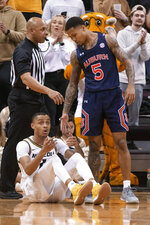 Missouri's Xavier Pinson, left, reacts after getting called for a foul on Auburn's J'Von McCormick, right, during the first half of an NCAA college basketball game Saturday, Feb. 15, 2020, in Columbia, Mo. (AP Photo/L.G. Patterson)