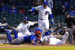 Chicago Cubs' Willson Contreras, front right, is safe at home plate as New York Mets catcher James McCann, front left, makes a late tag during the third inning of a baseball game, Thursday, April, 22, 2021, in Chicago. (AP Photo/David Banks)