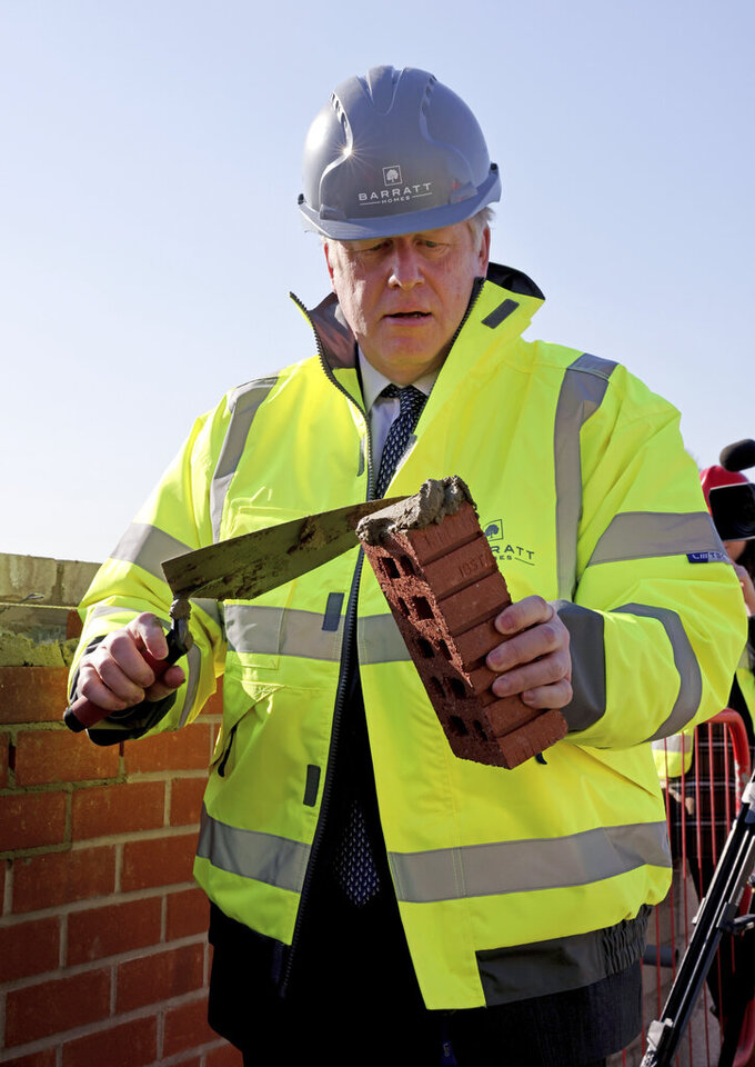 Britain's Prime Minister Boris Johnson poses for a photo during a visit to Barratt Homes development site Great Oldbury, in Gloucestershire, England, Monday, April 19, 2021, to launch the government's  95 percent mortgage guarantee scheme. (Jonathan Buckmaster, Pool Photo via AP)