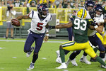 Houston Texans quarterback Joe Webb scrambles in the pocket, breaking away from Green Bay Packers linebacker Reggie Gilbert (93) during the second half of an NFL preseason football game Thursday, Aug. 8, 2019, in Green Bay, Wis. (AP Photo/Mike Roemer)
