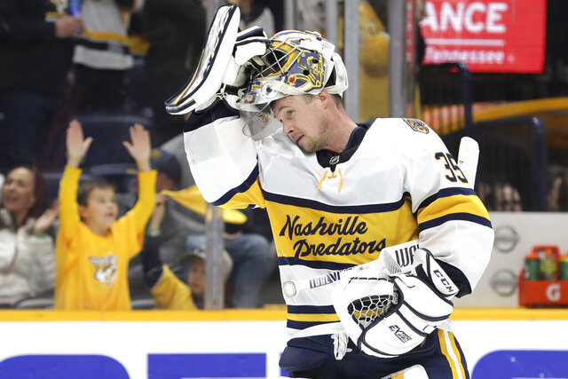 FILE - In this Feb. 16, 2020, file photo, Nashville Predators goaltender Pekka Rinne, of Finland, skates back to the net during the third period of the team's NHL hockey game against the St. Louis Blues in Nashville, Tenn. The NHL's pause has the clock ticking on the career of a former Vezina Trophy winner and four-time finalist with Rinne turning 38 in November. (AP Photo/Mark Humphrey, File)