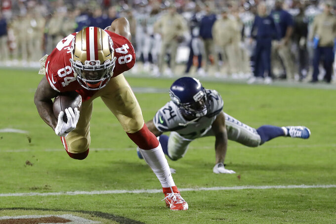 San Francisco 49ers wide receiver Kendrick Bourne (84) scores a touchdown past Seattle Seahawks cornerback Jamar Taylor (24) during the first half of an NFL football game in Santa Clara, Calif., Monday, Nov. 11, 2019. (AP Photo/Ben Margot)